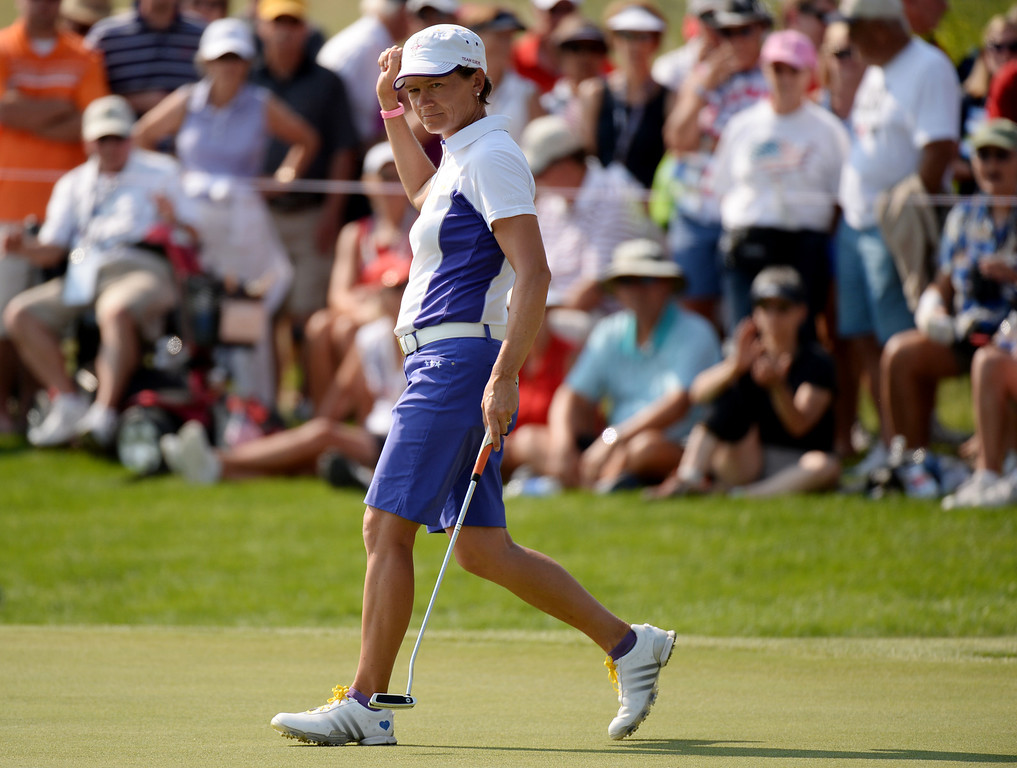 . PARKER, CO. - August 16: Catriona Matthew celebrates her birdie putt on 9th green during 2013 Solheim Cup at Colorado Golf Club. Parker, Colorado. August 16, 2013. (Photo By Hyoung Chang/The Denver Post)