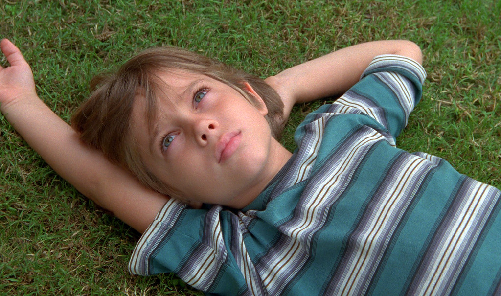 """. This image released by IFC Films shows Ellar Coltrane at age six in a scene from the film,\""""Boyhood.\"""" The film was nominated for a Golden Globe for best drama on Thursday, Dec. 11, 2014. The 72nd annual Golden Globe awards will air on NBC on Sunday, Jan. 11.  (AP Photo/IFC Films)"""