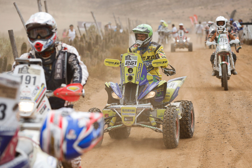. Yamaha quad rider Ignacio Casale, of Chile, center, arrives at the end of the special stage, part of the final 13th stage of the Dakar Rally in the quad category in Illapel, Chile, Saturday, Jan. 18, 2014. (AP Photo/Victor R. Caivano)