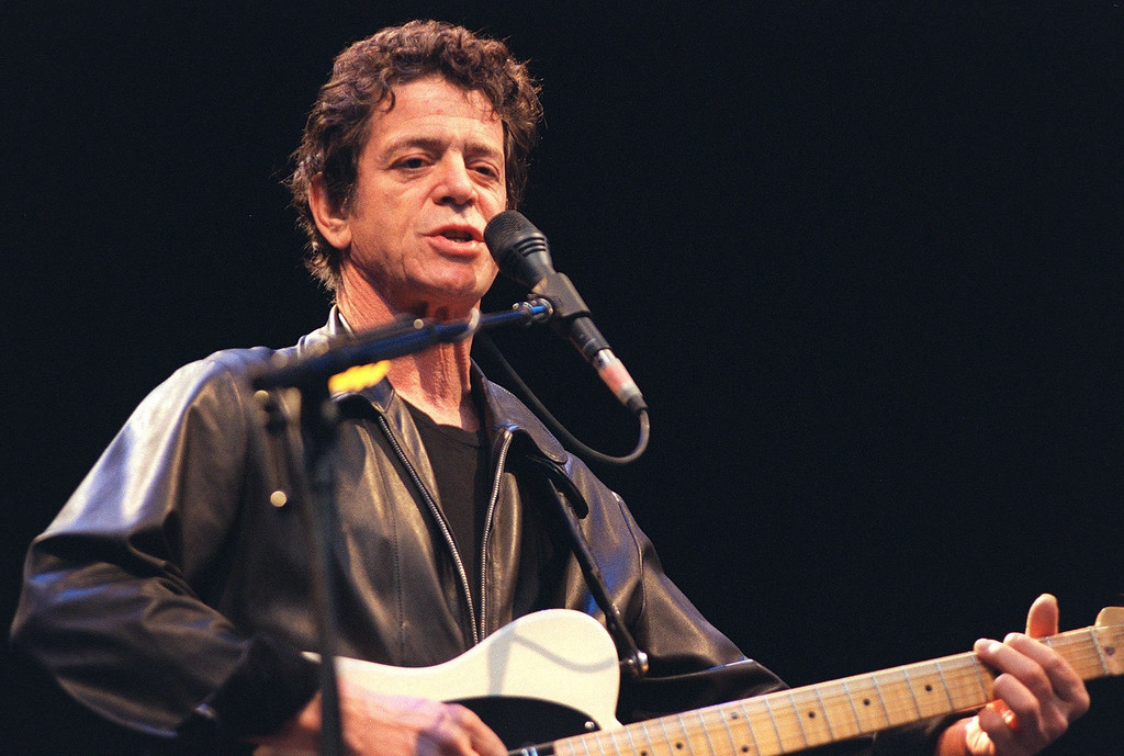 ". In this July 30, 2000 file photo, Lou Reed performs on stage at the open air ""Live at Sunset\"" concert in Zurich, Switzerland. Reed, the punk poet of rock \'n\' roll who profoundly influenced generations of musicians as leader of the Velvet Underground and remained a vital solo performer for decades after, died Oct. 27, 2013. He was 71. (AP Photo/Keystone, Monika Zaugg, File)"