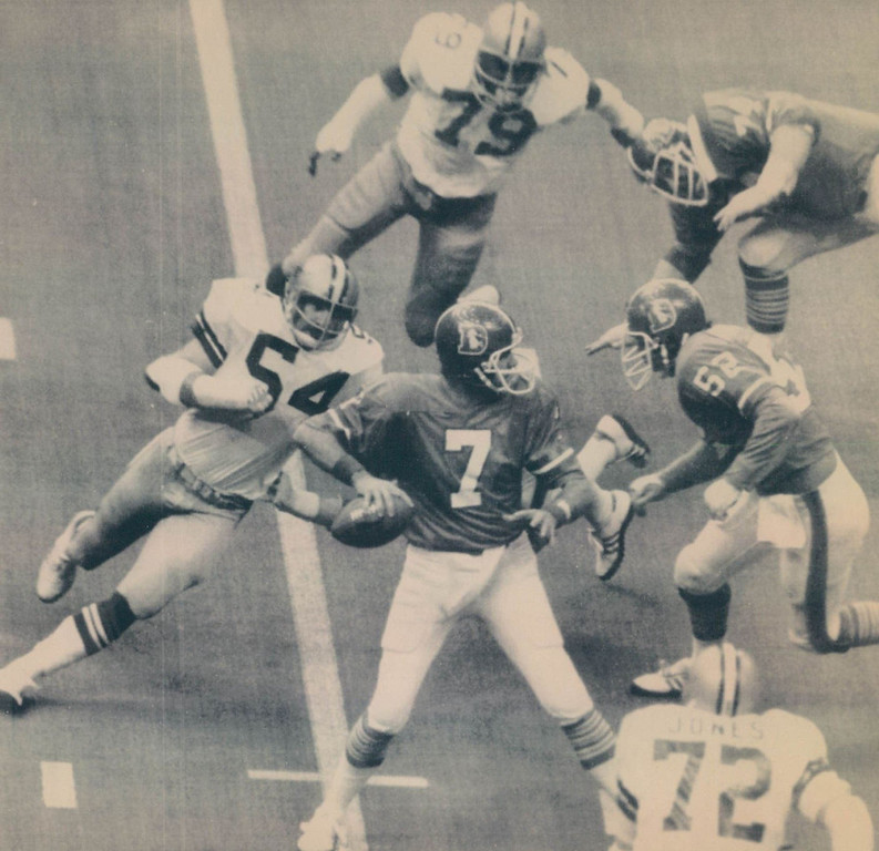 . The Cowboys defensive team dominated most of Super Bowl XII, forcing 8 turnovers and allowing only 8 pass completions by the Broncos for just 61 yards. Two of those interceptions led to 10 first-quarter points. Denver lost 27-10.    New Orleans, Jan. 16 - - Most Valuable Players in Action - - Randy White (54) and Harvey Martin (79) along with Ed Jones (72), all of Dallas, are closing in on Denver quarterback Craig Morton in Super Bowl XII action. White and Martin shared Most Valuable Player honors for the game. Other players are Mike Montier (52) and Andy Maurer (74) of Denver.  Denver Post