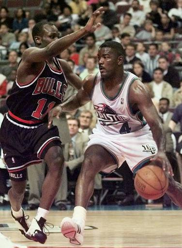 . FILE--Detroit Pistons\' Joe Dumars (4) drives against Chicago Bulls\' Charles Jones (11) during the first half April 1, 1999 in Auburn Hills, Mich. Dumars, will retire after this season with the Pistons after playing in 1,018 regular season games. (AP Photo/Duane Burleson)