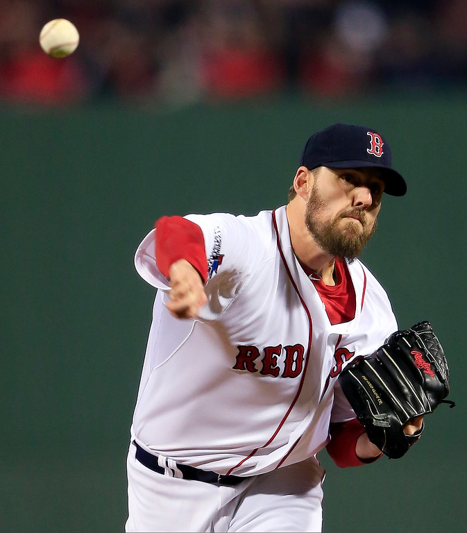 . Boston Red Sox starting pitcher John Lackey throws during the first inning of Game 6 of baseball\'s World Series against the St. Louis Cardinals Wednesday, Oct. 30, 2013, in Boston. (AP Photo/Jamie Squire, Pool)