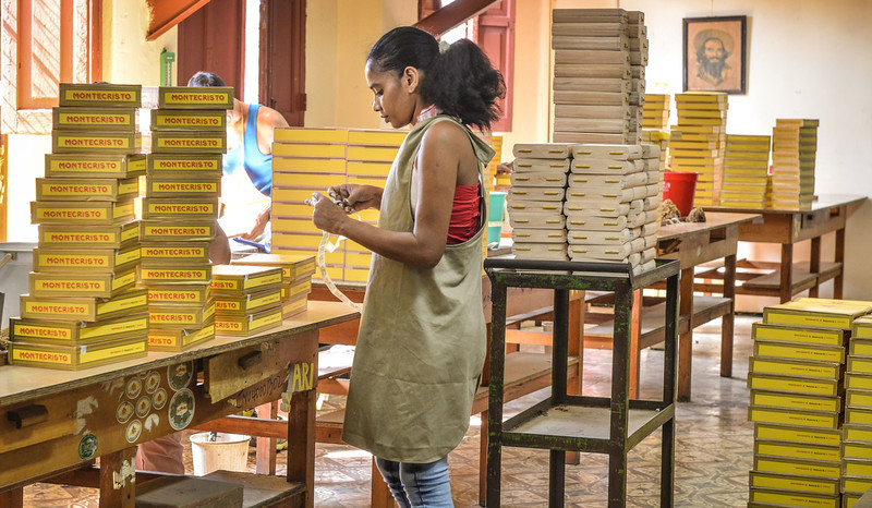 . Employees prepare boxes of cigars, on February 27, 2014 at the H. Upmann cigar factory in Havana. The production of Cuban cigars experienced an 8% growth in 2013 adding 447 million dollars to the Cuban economy. The XVI Havana Cigar Festival is running in Cuba with the presentation of the best Cuban cigars. (ALBERTO ROQUE/AFP/Getty Images)