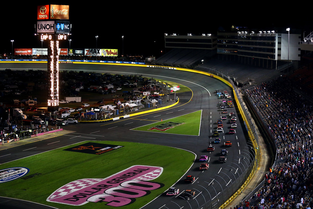. CONCORD, NC - OCTOBER 11: Cars race during the NASCAR Nationwide Series Dollar General 300 at Charlotte Motor Speedway on October 11, 2013 in Concord, North Carolina.  (Photo by Streeter Lecka/Getty Images)