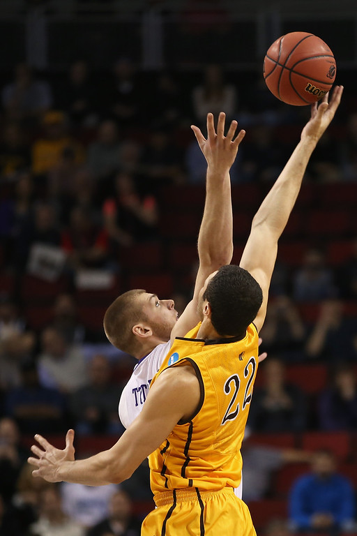 . Seth Tuttle #10 of the Northern Iowa Panthers and Larry Nance Jr. #22 of the Wyoming Cowboys jump for the tip off at the start of their game during the second round of the 2015 Men\'s NCAA Basketball Tournament at KeyArena on March 20, 2015 in Seattle, Washington.  (Photo by Otto Greule Jr/Getty Images)