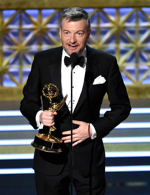". Charlie Brooker accepts the award for outstanding writing for a limited series, movie or a dramatic special for ""Black Mirror: San Junipero\"" at the 69th Primetime Emmy Awards on Sunday, Sept. 17, 2017, at the Microsoft Theater in Los Angeles. (Photo by Chris Pizzello/Invision/AP)"