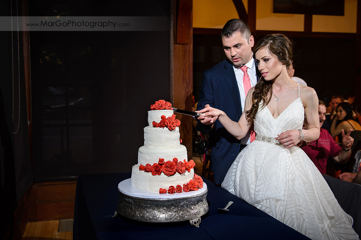 bride and groom cutting cake during wedding reception at Saratoga Foothill Club