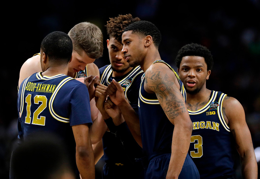 . Michigan players huddle before the start of the championship game against Villanova in the Final Four NCAA college basketball tournament, Monday, April 2, 2018, in San Antonio. (AP Photo/David J. Phillip)