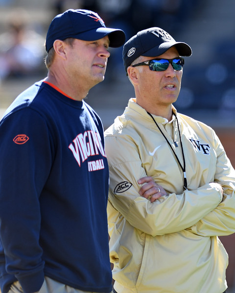 Coach Clawson & Coach Mendenhal pregame.jpg
