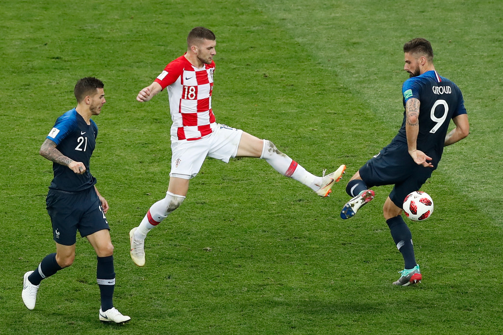 . Croatia\'s Ante Rebic, center, challenges for the ball with France\'s Lucas Hernandez, left, and France\'s Olivier Giroud during the final match between France and Croatia at the 2018 soccer World Cup in the Luzhniki Stadium in Moscow, Russia, Sunday, July 15, 2018. (AP Photo/Rebecca Blackwell)
