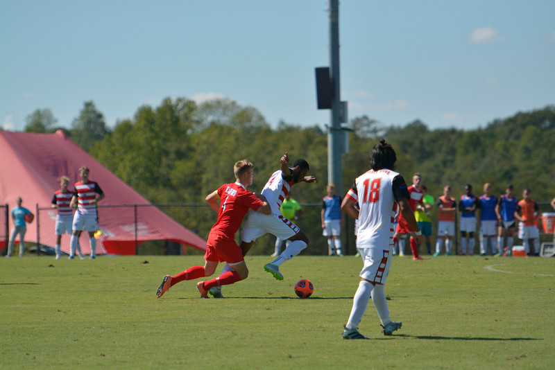 Mendy attempting to keep the ball away from Radford.