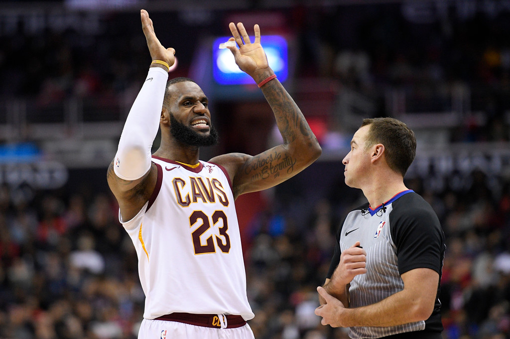 . Cleveland Cavaliers forward LeBron James (23) talks with an official after he was called for a foul during the second half of an NBA basketball game against the Washington Wizards, Sunday, Dec. 17, 2017, in Washington.  (AP Photo/Nick Wass)