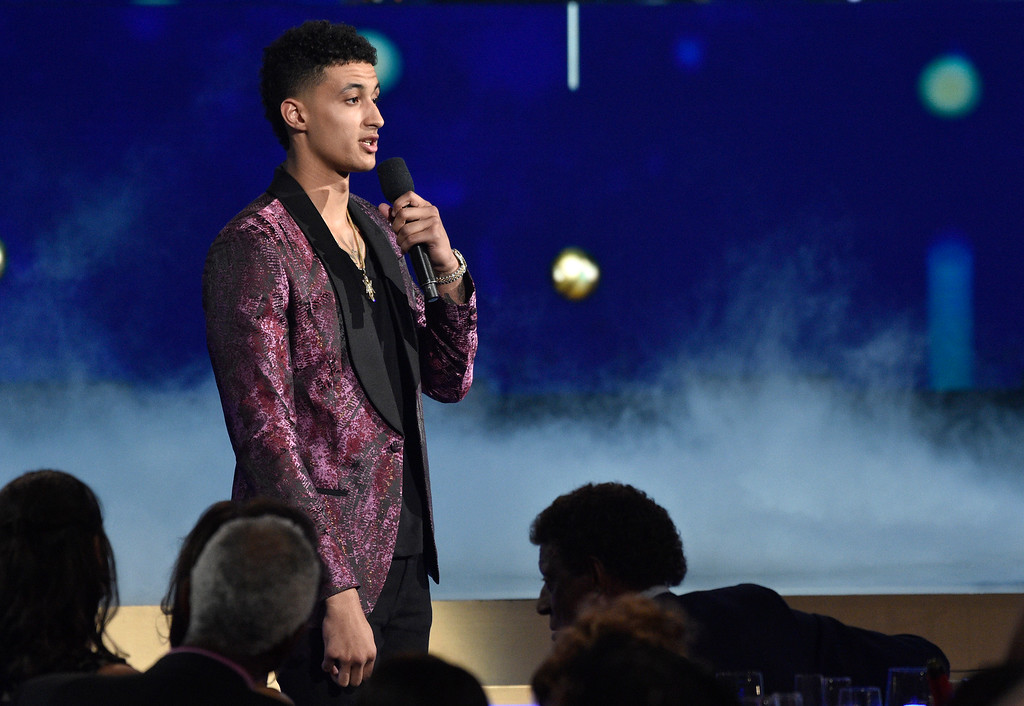 . NBA player Kyle Kuzma, of the Los Angeles Lakers, introduces a performance by Travis Scott at the NBA Awards on Monday, June 25, 2018, at the Barker Hangar in Santa Monica, Calif. (Photo by Chris Pizzello/Invision/AP)