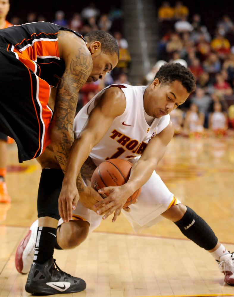 . Southern Cal guard Chass Bryan, right, steals the ball from Oregon State forward Eric Moreland, left, during the first half of an NCAA college basketball game, Saturday, Jan. 19, 2013, in Los Angeles. (AP Photo/Gus Ruelas)