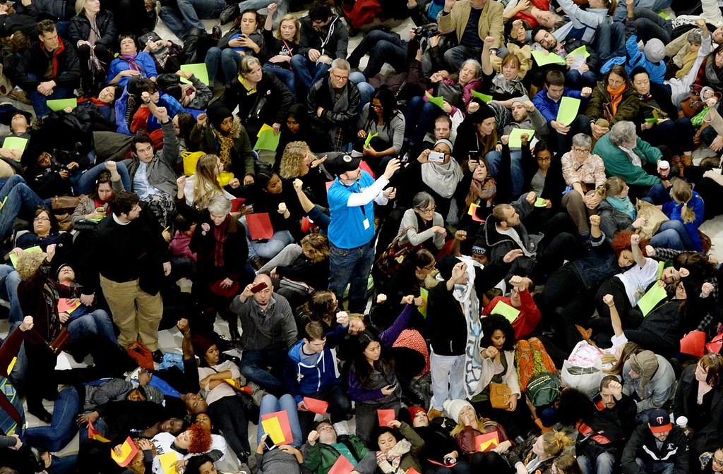 . A Mall of America staff member takes video of the demonstration as protesters lay down in the rotunda. (Pioneer Press: John Autey)