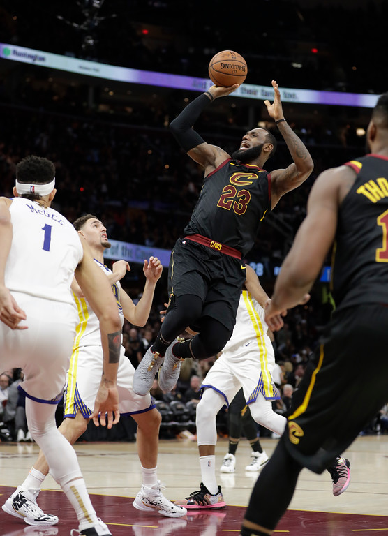 . Cleveland Cavaliers\' LeBron James shoots in the second half of Game 3 of basketball\'s NBA Finals against the Golden State Warriors, Wednesday, June 6, 2018, in Cleveland. (AP Photo/Tony Dejak)