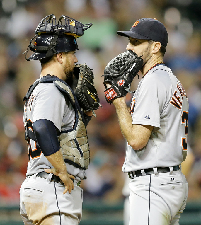 . Detroit Tigers\' Bryan Holaday, left, and Justin Verlander talk in the seventh inning of a baseball game against the Cleveland Indians, Wednesday, Sept. 3, 2014, in Cleveland. (AP Photo/Tony Dejak)