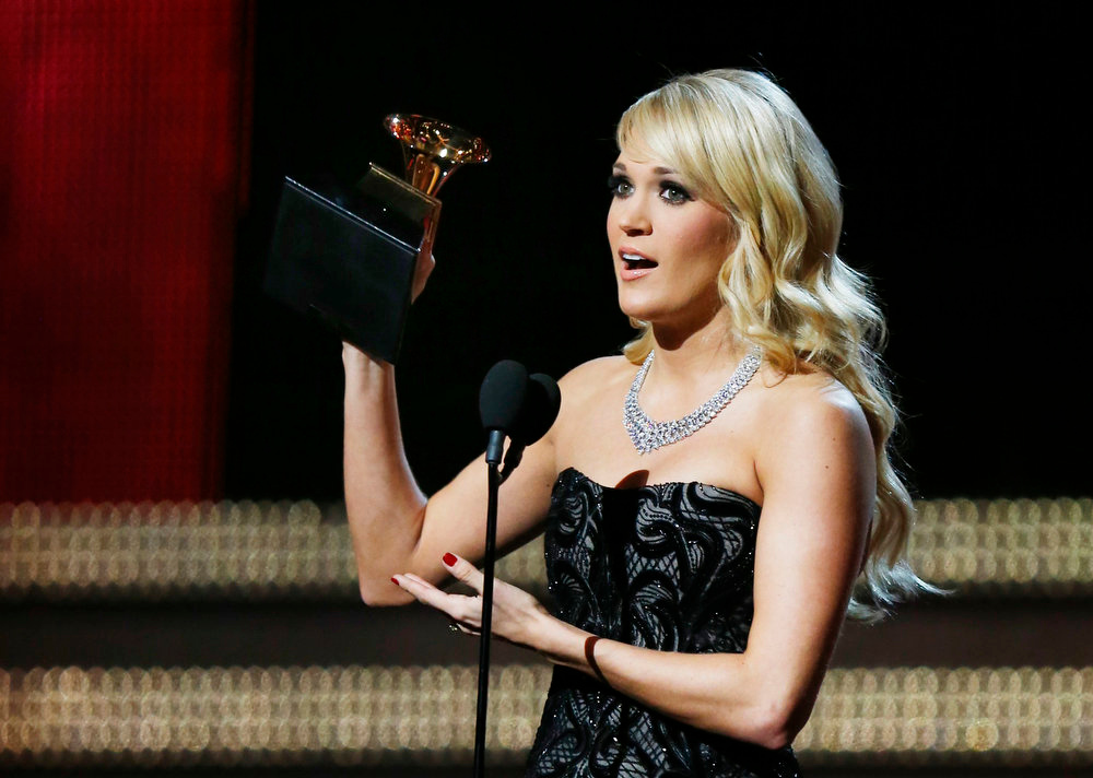 ". Carrie Underwood accepts the Grammy for best country solo performance for ""Blown Away\"" at the 55th annual Grammy Awards in Los Angeles, California, February 10, 2013.  REUTERS/Mike Blake"