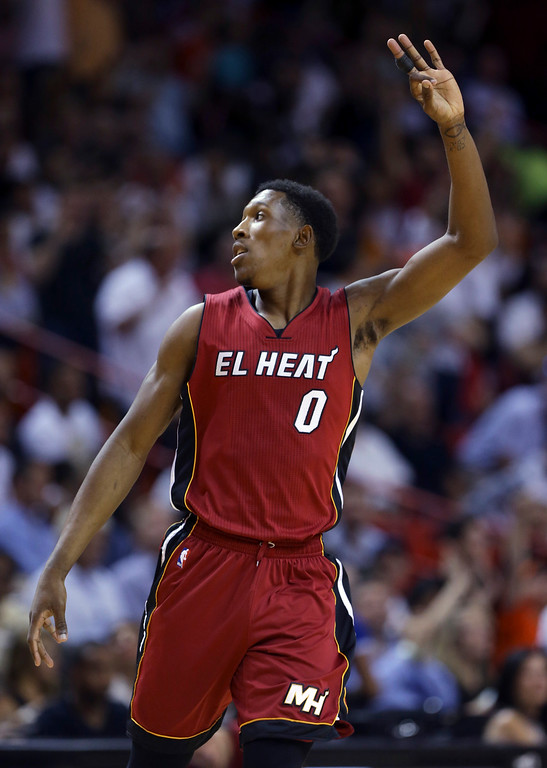 . Miami Heat guard Josh Richardson (0) reacts after scoring a three-pointer during the first half of an NBA basketball game against the Cleveland Cavaliers, Saturday, March 19, 2016, in Miami. (AP Photo/Lynne Sladky)
