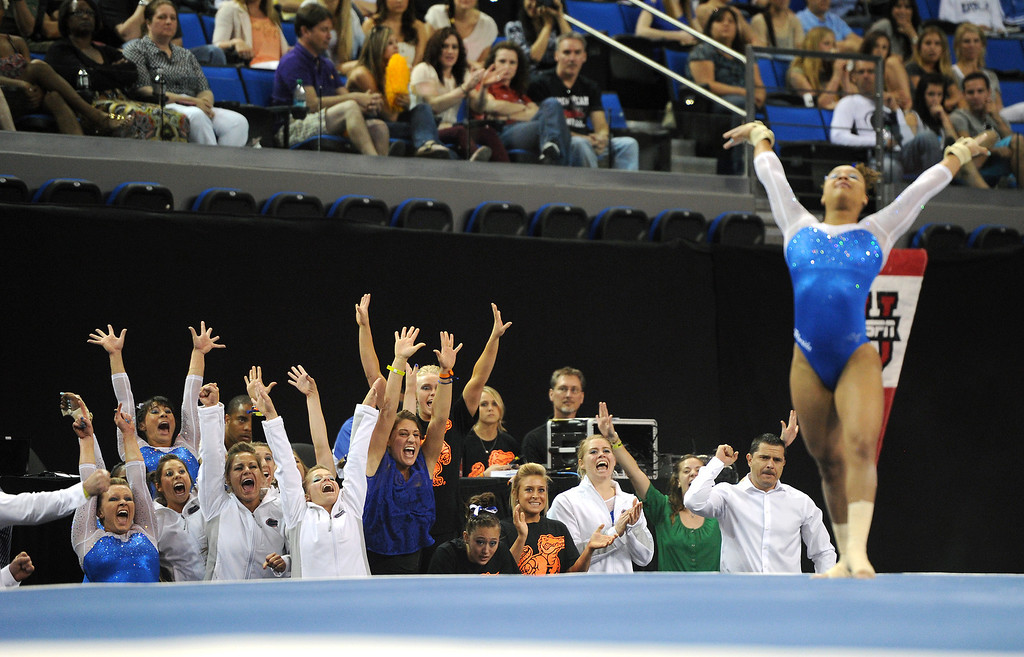 . Florida cheers as Kytra Hunter performs in the floor exercise at the NCAA Women\'s Gymnastics Championship Team Finals at Pauley Pavilion, Saturday, April 20, 2013. (Michael Owen Baker/Staff Photographer)