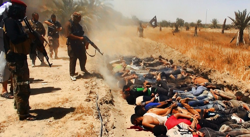 """. An image uploaded on June 14, 2014 on the jihadist website Welayat Salahuddin allegedly shows militants of the Islamic State of Iraq and the Levant (ISIL) executing dozens of captured Iraqi security forces members at an unknown location in the Salaheddin province. A major offensive spearheaded by ISIL but also involving supporters of executed dictator Saddam Hussein has overrun all of one province and chunks of three others since it was launched on June 9. AFP PHOTO / HO / WELAYAT SALAHUDDIN === RESTRICTED TO EDITORIAL USE - MANDATORY CREDIT \""""AFP PHOTO / HO / WELAYAT SALAHUDDIN\"""" - NO MARKETING NO ADVERTISING CAMPAIGNS - DISTRIBUTED AS A SERVICE TO CLIENTS FROM ALTERNATIVE SOURCES, AFP IS NOT RESPONSIBLE FOR ANY DIGITAL ALTERATIONS TO THE PICTURE\'S EDITORIAL CONTENT, DATE AND LOCATION WHICH CANNOT BE INDEPENDENTLY VERIFIED ===-/AFP/Getty Images"""
