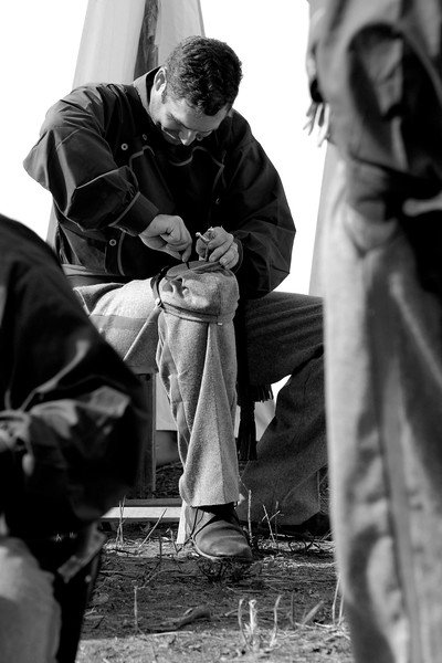 A Confederate reenactor makes repairs to his hat near the end of the day at Patriots Point in Mt. Pleasant, South Carolina on Sunday, April 10, 2011. ..The 150th Anniversary of the Firing on Ft. Sumter was commemorated with lectures, performances, demonstrations, and a living history throughout the area on James Island, Charleston, Mt. Pleasant, and Sullivan's Island during the week from April 8-14, 2011. Photo Copyright 2011 Jason Barnette