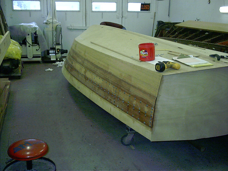 Secod two planks installed and held in place with tempory fasteners starboard side.