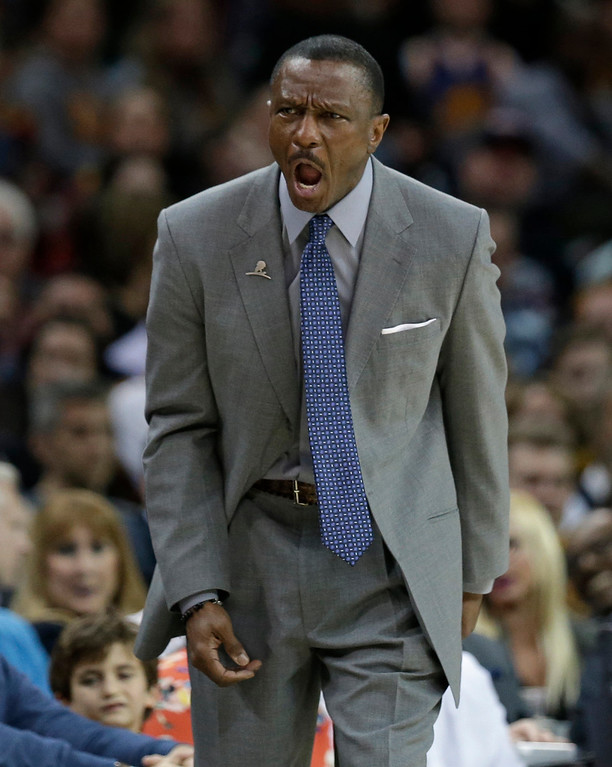 . Toronto Raptors head coach Dwane Casey yells instructions to players in the first half of an NBA basketball game against the Cleveland Cavaliers, Wednesday, April 12, 2017, in Cleveland. The Raptors won 98-83. (AP Photo/Tony Dejak)