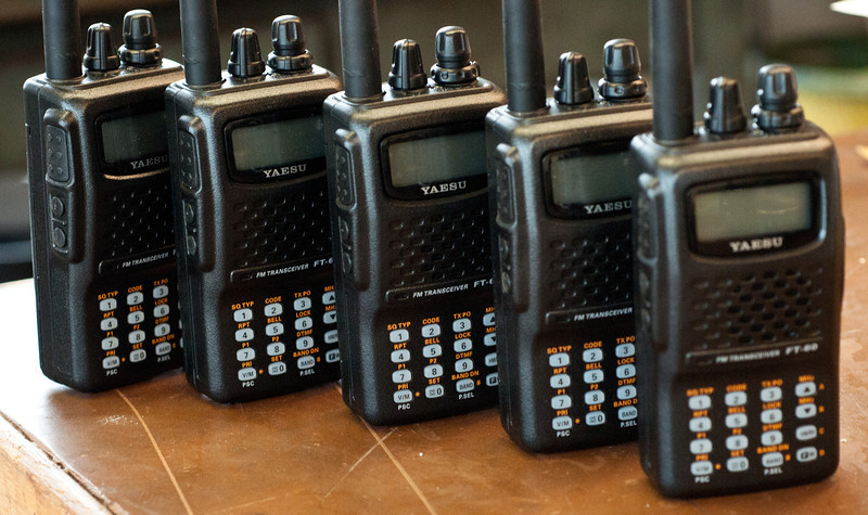 """Our handhelds, out for loan, donated by CAA! The backs are laser-engraved, """"W8EDU""""."""