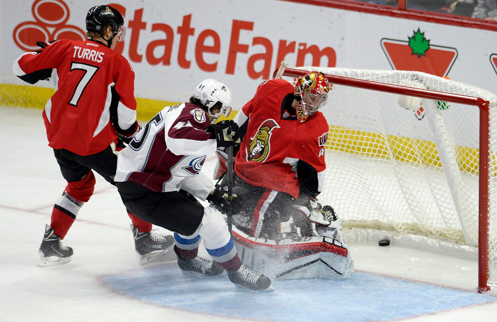 . Ottawa Senators goaltender Craig Anderson (41) looks behind him as the puck goes in the net as Colorado Avalanche\'s Dennis Everberg (45) and Senators\' Kyle Turris (7) watch during the first period of an NHL hockey game Thursday, Ocyt. 16, 2014, in Ottawa, Ontario. (AP Photo/The Canadian Press, Justin Tang)