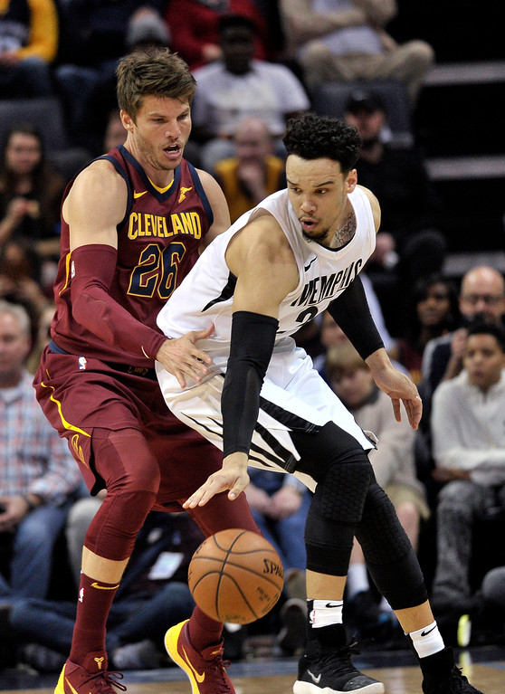 . Memphis Grizzlies forward Dillon Brooks, right, controls the ball against Cleveland Cavaliers guard Kyle Korver during the first half of an NBA basketball game Friday, Feb. 23, 2018, in Memphis, Tenn. (AP Photo/Brandon Dill)