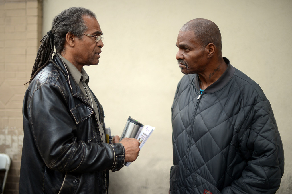 . JWCH Institute Lead Community Outreach Worker Christopher Mack talks to Gerry Flyod about health care in the Skid-row area of Los Angeles Wednesday, April 24, 2013. (Hans Gutknecht/Staff Photographer)