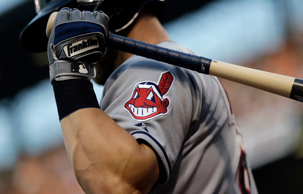 . FILE - This June 26, 2015, file photo, shows the Cleveland Indians logo on a jersey during a baseball game against the Baltimore Orioles in Baltimore.  Indians are taking the divisive Chief Wahoo logo off their uniforms and caps, starting in 2019. (AP Photo/Patrick Semansky, File)