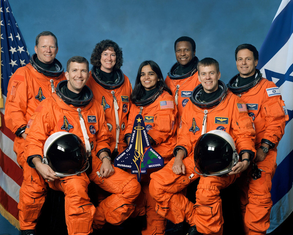 . The crew of Space Shuttle Columbia\'s mission STS-107 pose for the traditional crew portrait. Seated in front are astronauts Rick D. Husband (L), mission commander; Kalpana Chawla, mission specialist; and William C. McCool, pilot. Standing are (L to R) astronauts David M. Brown, Laurel B. Clark, and Michael P. Anderson, all mission specialists; and Ilan Ramon, payload specialist representing the Israeli Space Agency. Columbia broke up upon re-entry to earth February 1, 2003. The Columbia Accident Investigation Board investigators say that a culture of low funding, strict scheduling and an eroded safety program at NASA doomed the flight of the space shuttle.  (Photo by NASA/Getty Images)