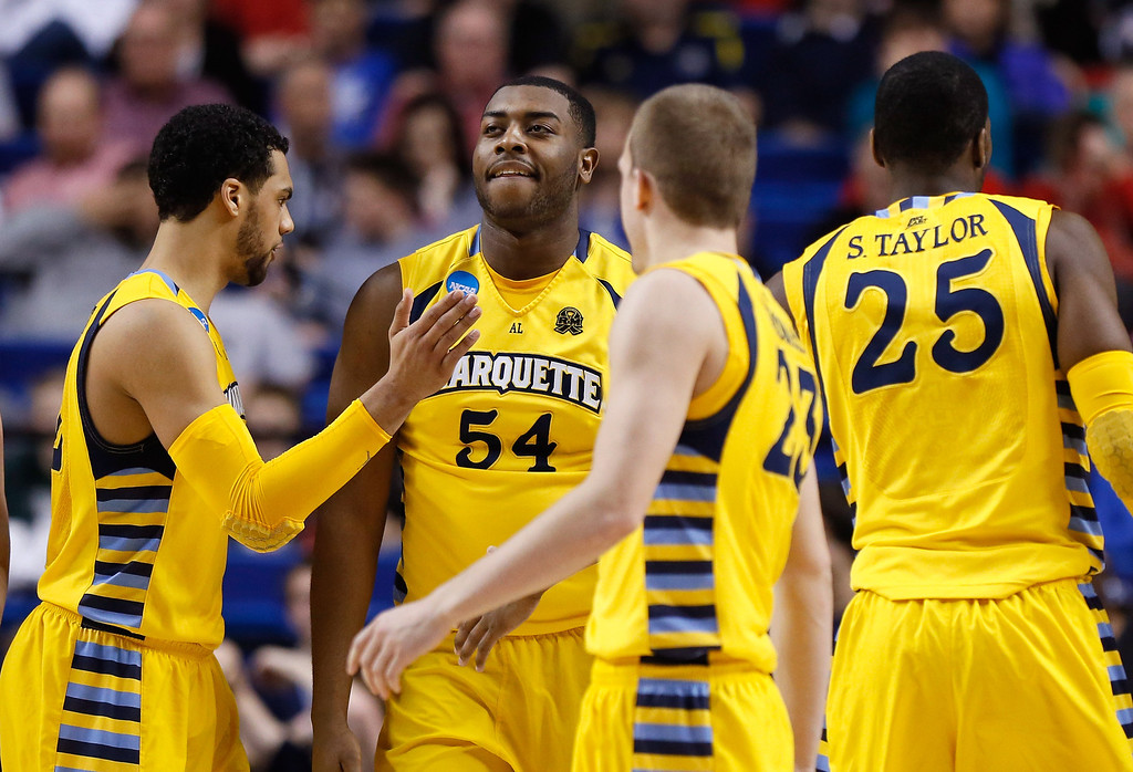. LEXINGTON, KY - MARCH 23: Davante Gardner #54 of the Marquette Golden Eagles reacts with teammates Trent Lockett #22, Jake Thomas #23 and Steve Taylor, Jr. #25 against the Butler Bulldogs in the second half during the third round of the 2013 NCAA Men\'s Basketball Tournament at Rupp Arena on March 23, 2013 in Lexington, Kentucky.  (Photo by Kevin C. Cox/Getty Images)