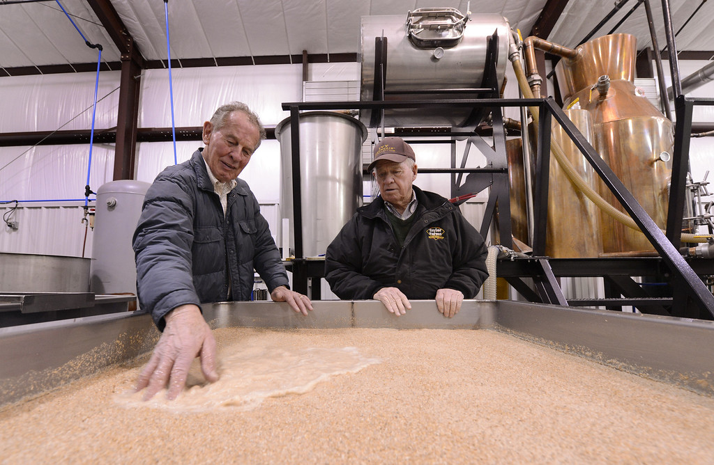 . Carlos Lovell (R), 85, and his brother Fred, 83, survey a vat of their fermenting corn sour mash whiskey before it is boiled in the still behind them at the Ivy Mountain Distillery in Mt. Airy, Georgia, USA, 26 February 2013. The Lovell family began distilling the once illegal moonshine 150 years ago in the north Georgia mountains. Carlos and Fred learned how to make moonshine when they were teenagers, and continued making the 95 proof spirits until the early 1960s, but now have resumed their craft legally.  EPA/ERIK S. LESSER