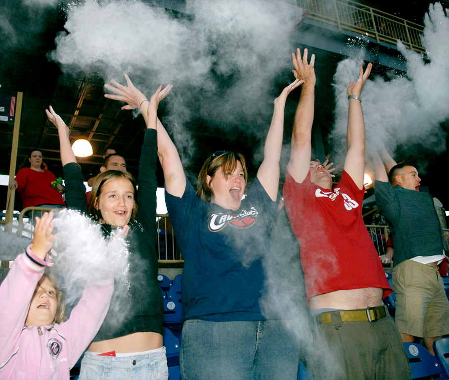 . Jeff Forman/JForman@News-Herald.com Kim Aikey, of Mentor, and her daughters Ashlyn, left, and Megan Slocum and friend Doug Luther mimic LeBron James\' pre-game powder-throwing ritual Thursday as they join with other Captains fans at Classic Park to plead with James to stay in Cleveland.