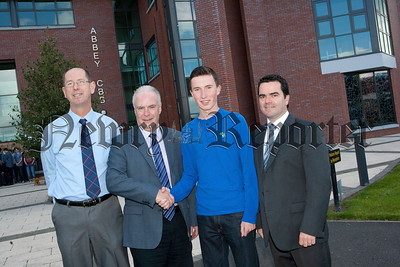 "Mr Dermot McGovern Headmaster Abbey Christian Brothers Grammar School Newry congratulates ""Top of the Class"" Ronan Lavery who achieved an outstanding 12 A* grades in his GCSE examinations. Also included are Mr Paul O'Shea and Mr Ronan Ruddy Vice Principals. R1435010"