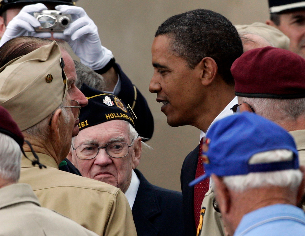 . ** ALTERNATIVE CROP XFM109 ** U.S. President Barack Obama greets veterans during the 65th Anniversary of the D-day landings in Normandy at the American Cemetery at Colleville-Sur -Mer, near Caen, western France, Saturday, June 6, 2009. (AP Photo/Francois Mori)