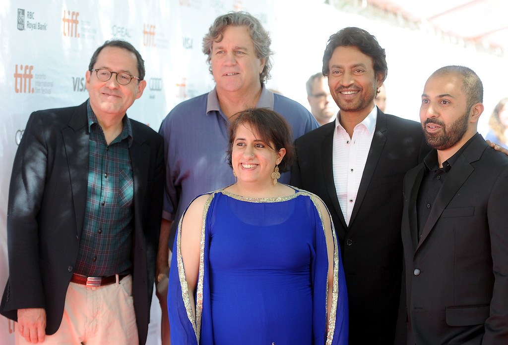 """. (L-R) Co-Presidents of Sony Pictures Classics Michael Barker and Tom Bernard, producer Guneet Monga (front),  actor Irrfan Khan, and director Ritesh Batra arrive at the \""""The Lunchbox\"""" Premiere during the 2013 Toronto International Film Festival at Roy Thomson Hall on September 8, 2013 in Toronto, Canada.  (Photo by Jag Gundu/Getty Images)"""