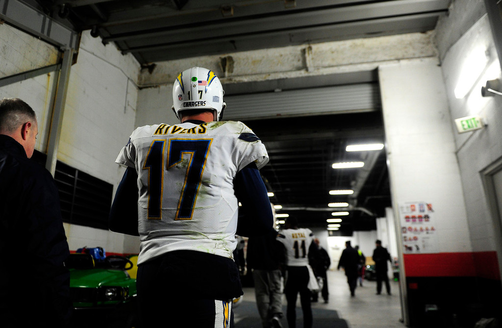 . San Diego Chargers quarterback Philip Rivers (17) leaves the field at the end of the game. The Denver Broncos take on the San Diego Chargers at Sports Authority Field at Mile High in Denver on January 12, 2014. (Photo by AAron Ontiveroz/The Denver Post)