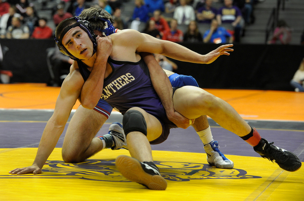 . DENVER, CO. - FEBRUARY 21: Akron High School wrestler Asutin Spear, back, wrapped up Panther\'s senior Jacob Pino, front, in a 160-pound bout in class 2A Thursday. The CHSAA State Wrestling Tournament kicked off Thursday, February 21, 2013 at the Pepsi Center in Denver.  (Photo By Karl Gehring/The Denver Post)