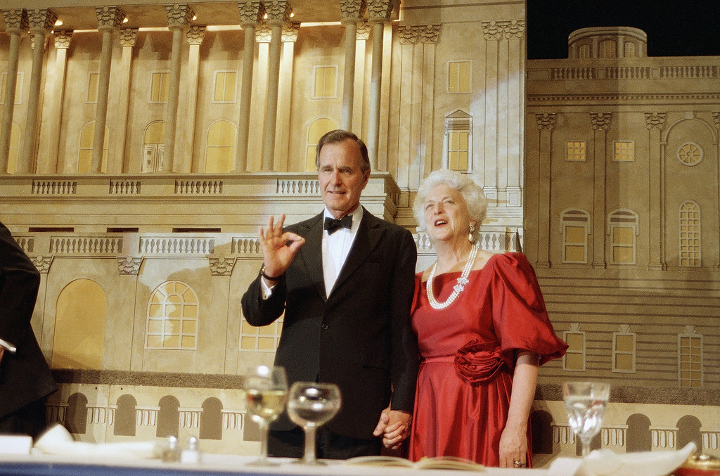 . Vice President George Bush and his wife Barbara Bush are shown during a fundraiser in Washington where he picked up the endorsement of President Reagan in his bid to become the next president of the United States, May 12, 1988.  (AP Photo/Charles Tasnadi)