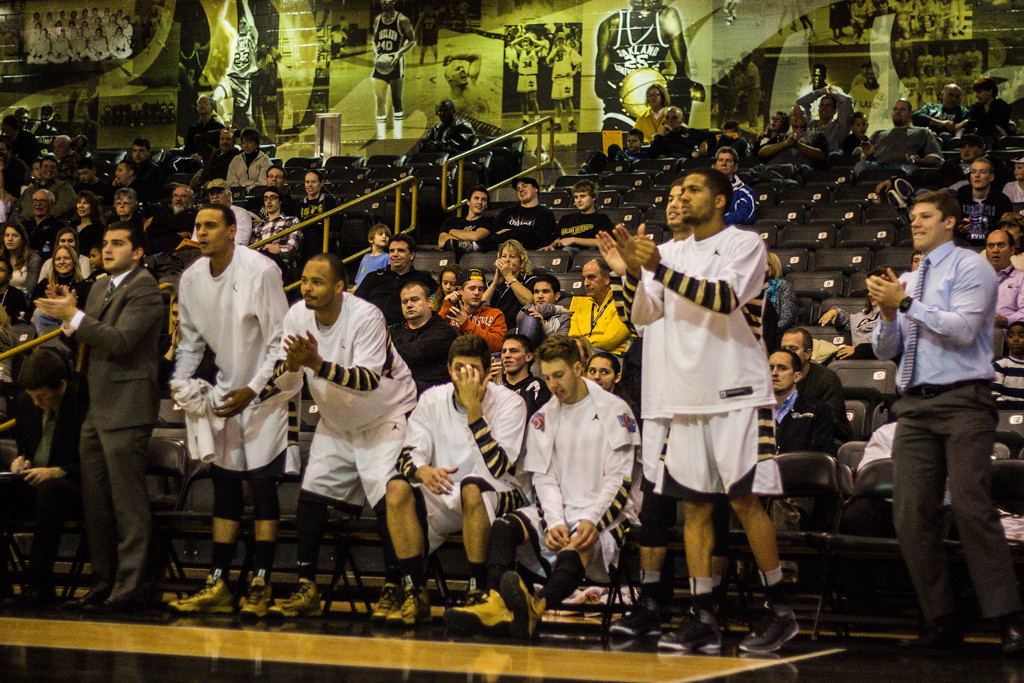 . OU players cheer on their teammates in the closing minutes of the game. Photo by Dylan Dulberg