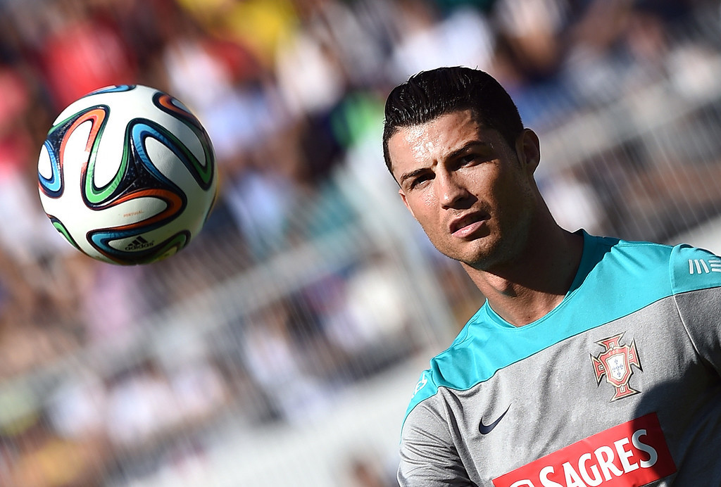 . Portugal\'s forward Cristiano Ronaldo controls the ball as he takes part in a team training session in Campinas, Sao Paulo, on June 18, 2014, during the 2014 FIFA World Cup. JEWEL SAMAD/AFP/Getty Images