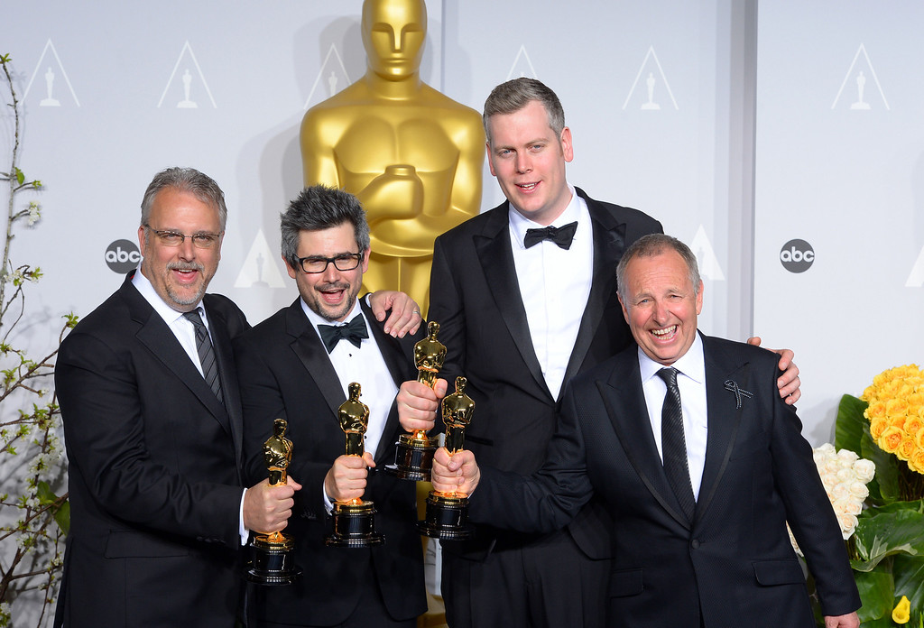 ". Skip Lievsay, Niv Adiri, Christopher Benstead and Chris Munro accept the Award for ""Achievement in Sound Mixing for the film Gravity, backstage at the 86th Academy Awards at the Dolby Theatre in Hollywood, California on Sunday March 2, 2014 (Photo by David Crane / Los Angeles Daily News)"