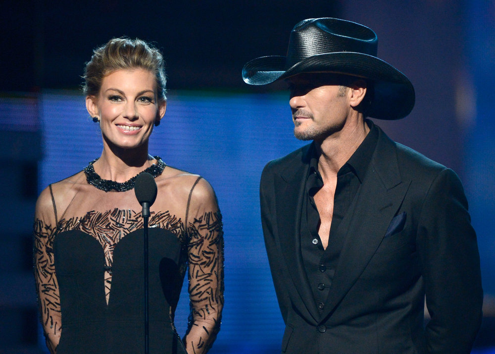 Description of . Singers Faith Hill and Tim McGraw speak onstage at the 55th Annual GRAMMY Awards at Staples Center on February 10, 2013 in Los Angeles, California.  (Photo by Kevork Djansezian/Getty Images)