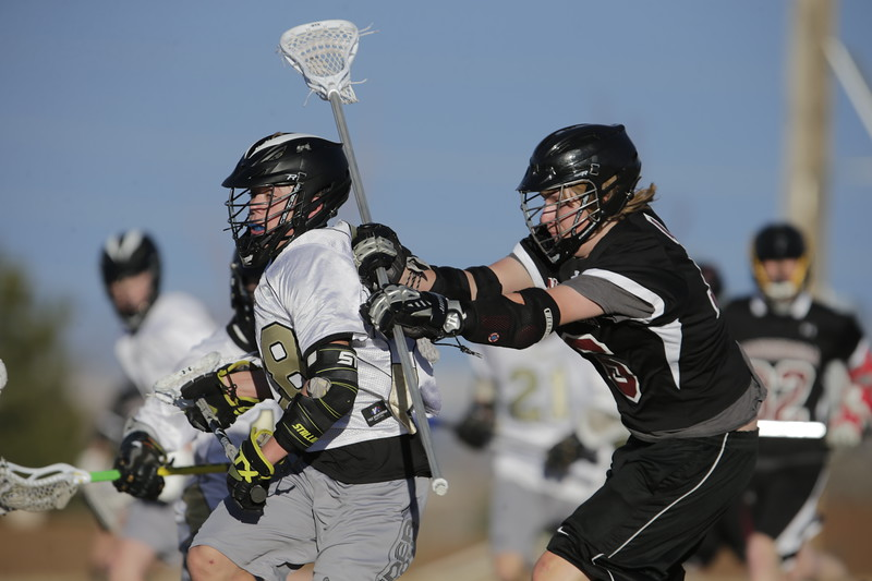 JPM0324-JPM0324-Jonathan first HS lacrosse game March 9th.jpg