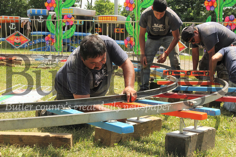 Workers put the finishing touches on a train ride at the Big Butler Fairgrounds. Seb Foltz/Butler Eagle